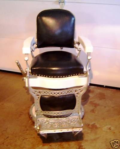 This Super White Porcelain And Black Upholstered Barber Chair